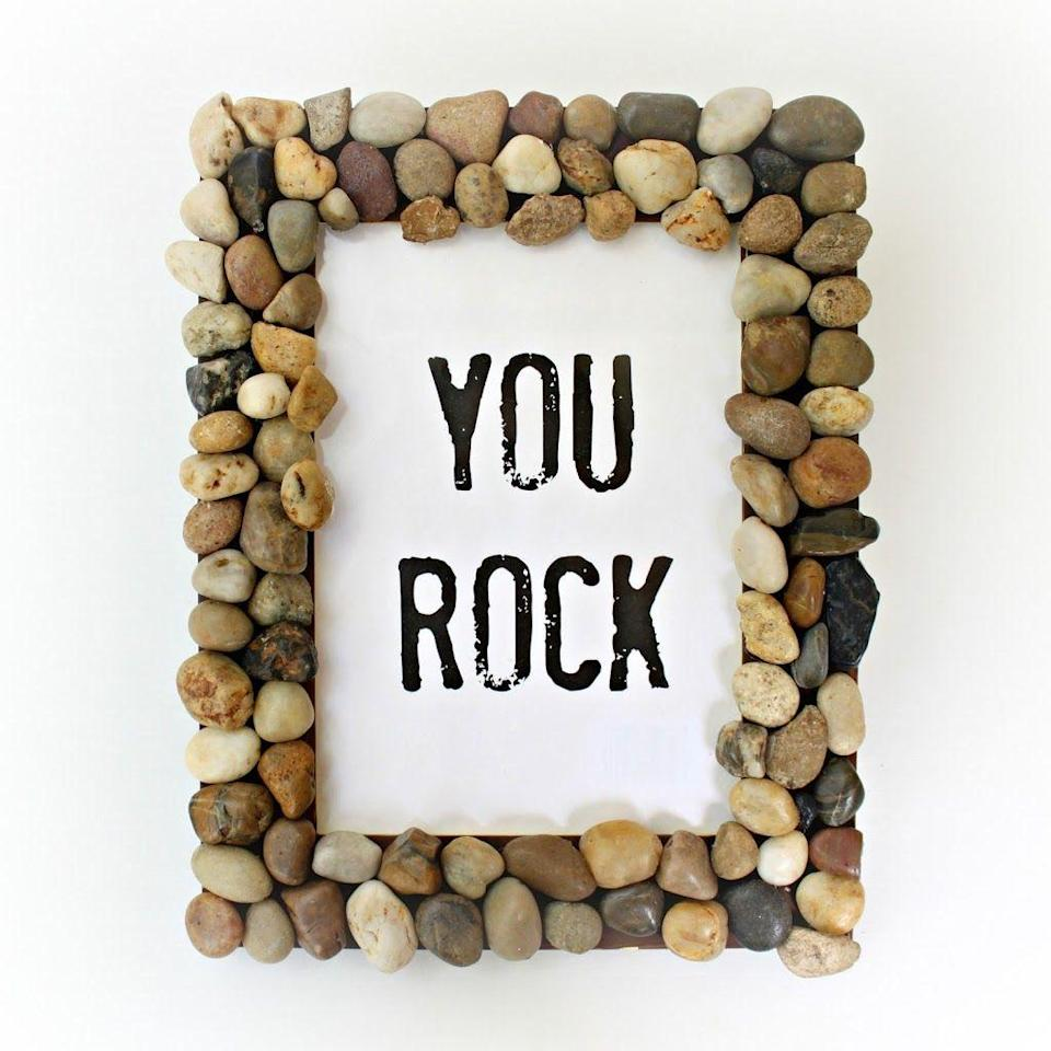 """<p>All you need is paint, polished rocks and super glue to turn an old picture frame into a fun gift for Dad. To save a few dollars, collect small rocks from a hike or your yard. Add a picture Dad will love or keep it punny with a print-out expression. </p><p><strong>Get the tutorial at <a href=""""http://www.morenascorner.com/2014/06/diy-rocky-picture-frame.html"""" rel=""""nofollow noopener"""" target=""""_blank"""" data-ylk=""""slk:Morena's Corner"""" class=""""link rapid-noclick-resp"""">Morena's Corner</a>.</strong> </p>"""