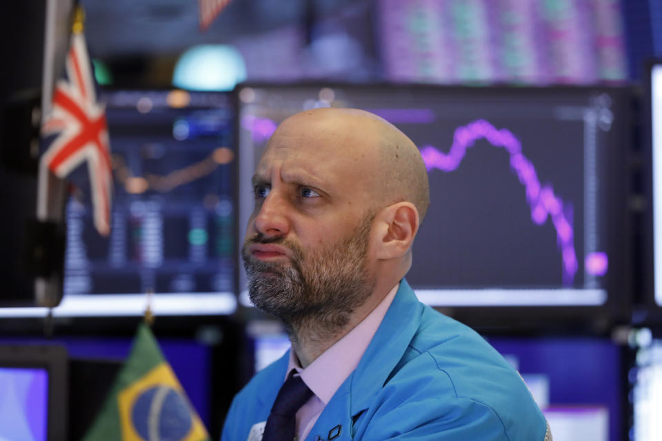 Specialist Meric Greenbaum works at his post on the floor of the New York Stock Exchange, Monday, March 9, 2020. The Dow Jones Industrial Average sank 7.8%, its steepest drop since the financial crisis of 2008, as a free-fall in oil prices and worsening fears of fallout from the spreading coronavirus outbreak seize markets. (AP Photo/Richard Drew)