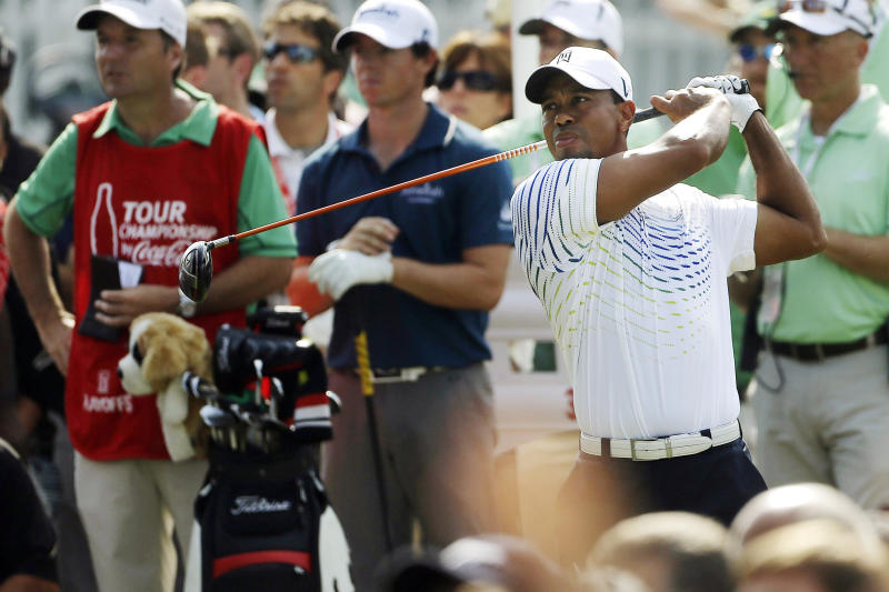 Tiger Woods hits from the tee on the 13th hole during the first round of the Tour Championship golf tournament, Thursday, Sept. 20, 2012, in Atlanta. (AP Photo/John Bazemore)