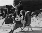 <p>Actress Mildred Harris, the first wife of Charlie Chaplin, applies make-up on set, circa 1923.</p>