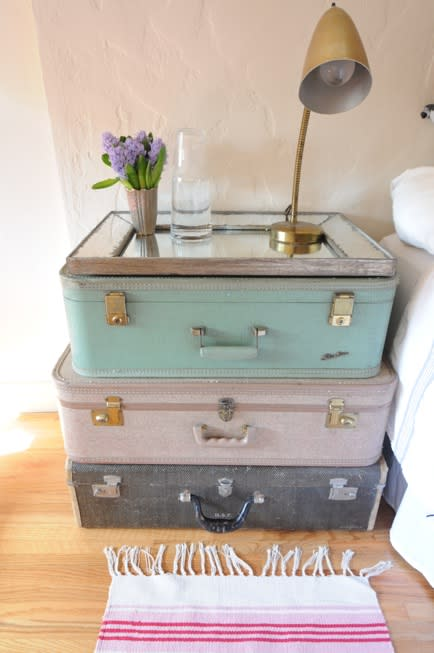 """<div class=""""caption-credit""""> Photo by: Cupcakes and Cashmere</div><b>Vintage Suitcase Nightstand</b> <br> This clever idea is lovely and functional. The suitcases are great for storage and can be stacked to make a nightstand! <br> <b><i><a href=""""http://blogs.babble.com/the-new-home-ec/2012/01/14/15-ways-to-organize-a-small-home-or-apartment/"""" rel=""""nofollow noopener"""" target=""""_blank"""" data-ylk=""""slk:Related: 15 inventive ways to organize a small dorm room or apartment"""" class=""""link rapid-noclick-resp"""">Related: 15 inventive ways to organize a small dorm room or apartment</a></i></b>"""