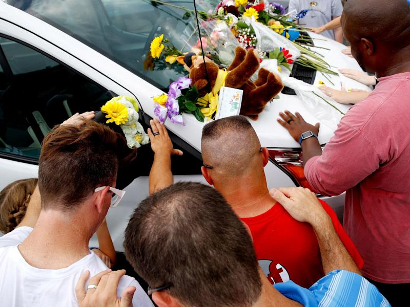 The victims' cars, left in a nearby parking lot ahead of the tour, were adorned with flowers, stuffed animals, balloons and handwritten notes expressing condolences: AP