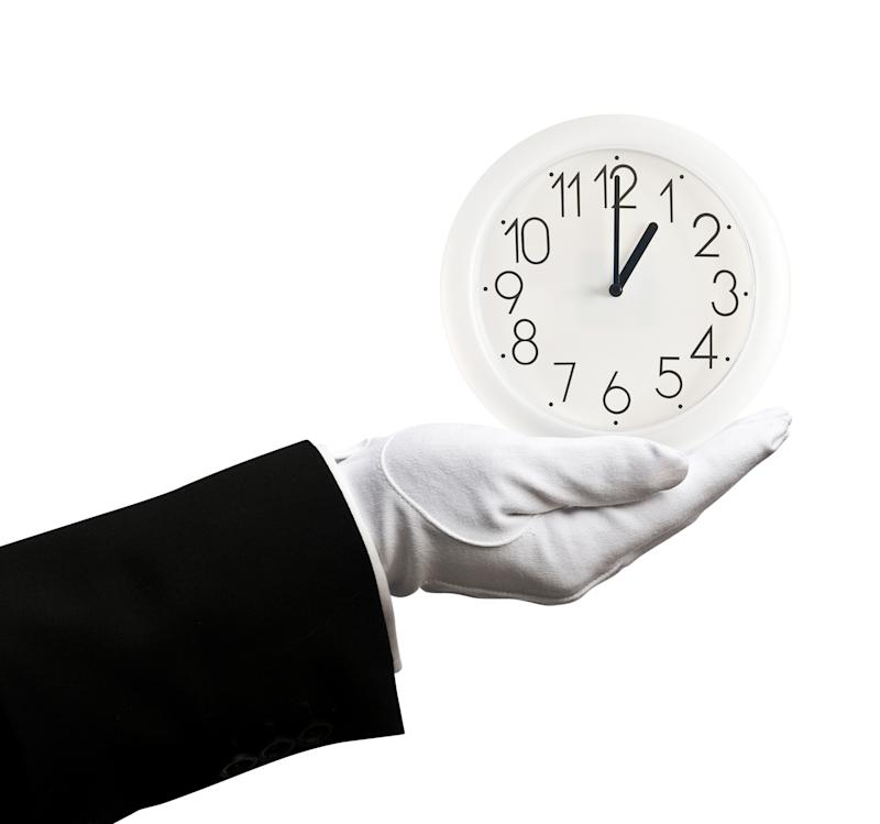 Butler holding clock at 1 o'clock