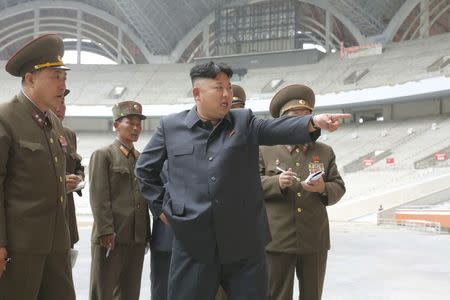 North Korean leader Kim Jong Un gives field guidance to the remodelling site of the May Day Stadium in this undated photo released by North Korea's Korean Central News Agency (KCNA) in Pyongyang
