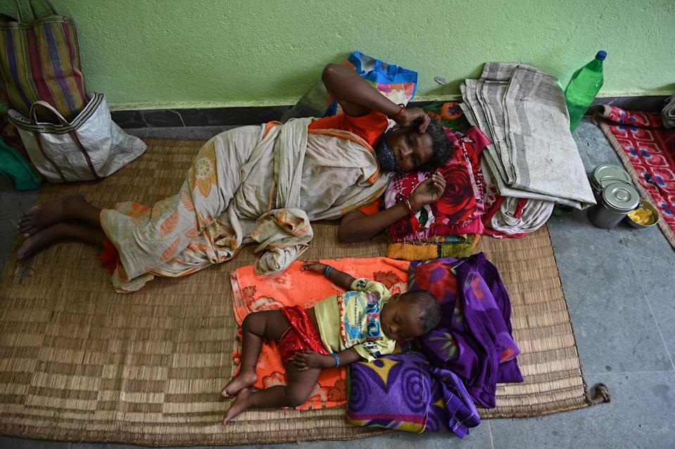 Villagers resting at a rescue shelter ahead of Cyclone Yaas making landfall (AFP via Getty Images)