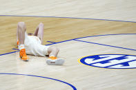 Tennessee's John Fulkerson lies on the court after being fouled by Florida's Omar Payne in the second half of an NCAA college basketball game in the Southeastern Conference Tournament Friday, March 12, 2021, in Nashville, Tenn. Payne was ejected from the game. (AP Photo/Mark Humphrey)