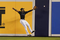 Miami Marlins right fielder Bryan De La Cruz can't make the catch on a double by Pittsburgh Pirates Ke'Bryan Hayes during the first inning of a baseball game Saturday, Sept. 18, 2021, in Miami. (AP Photo/Marta Lavandier)