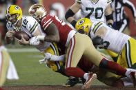 Green Bay Packers quarterback Aaron Rodgers (12) is sacked by San Francisco 49ers defensive tackle DeForest Buckner, center, and San Francisco 49ers defensive end Arik Armstead, bottom, during the second half of an NFL football game in Santa Clara, Calif., Sunday, Nov. 24, 2019. (AP Photo/Ben Margot)