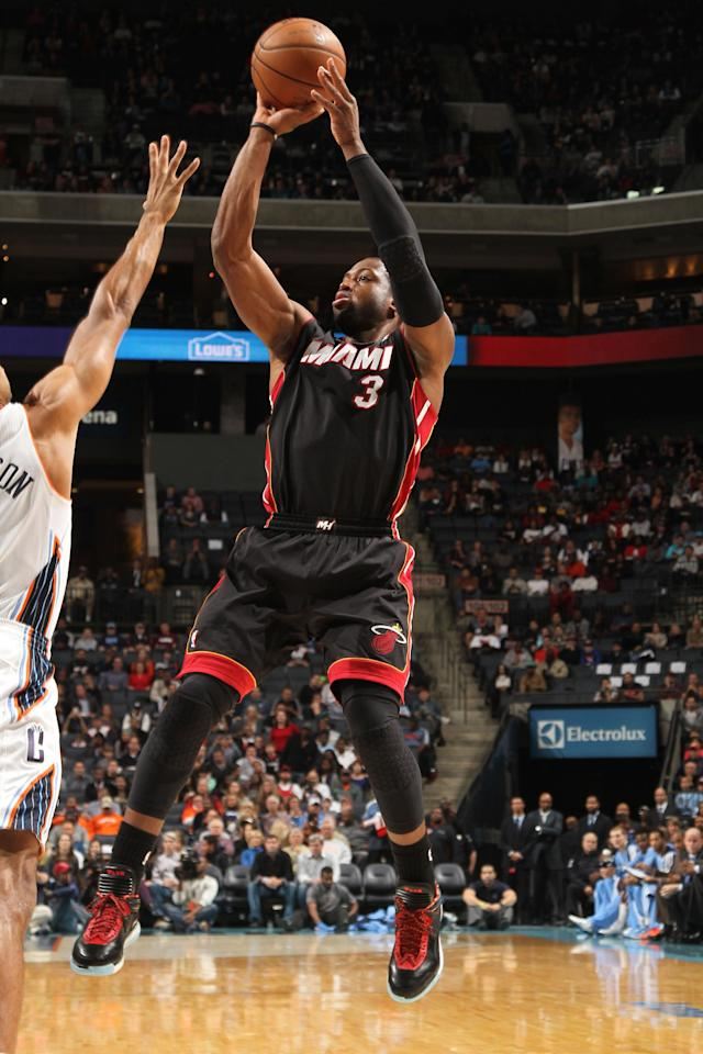CHARLOTTE, NC - NOVEMBER 16: Dwayne Wade #3 of the Miami Heat shoots against the Charlotte Bobcats during the game at the Time Warner Cable Arena on November 16, 2013 in Charlotte, North Carolina. (Photo by Brock Williams-Smith/NBAE via Getty Images)