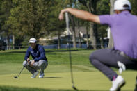 Jon Rahm, of Spain, lines up a putt on the fifth green during the third round of the US Open Golf Championship, Saturday, Sept. 19, 2020, in Mamaroneck, N.Y. (AP Photo/John Minchillo)