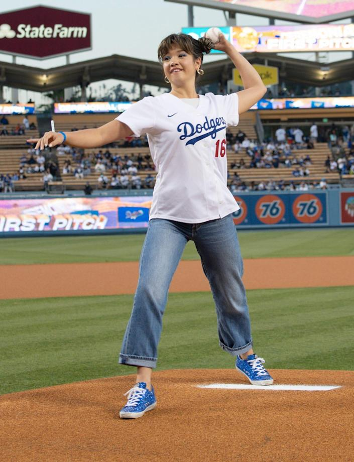 <p><i>Doogie Kamealoha, M.D.</i> star Peyton Elizabeth Lee throws the first pitch at the L.A. Dodgers game at Dodger Stadium on Sept. 14 in L.A. </p>