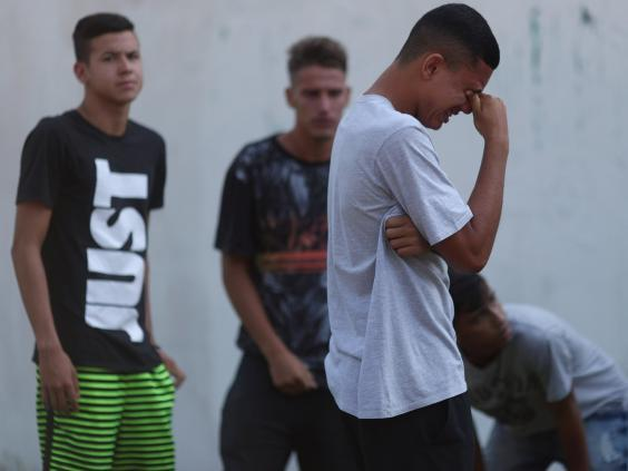People wait for information outside Flamengo's training complex (Reuters)