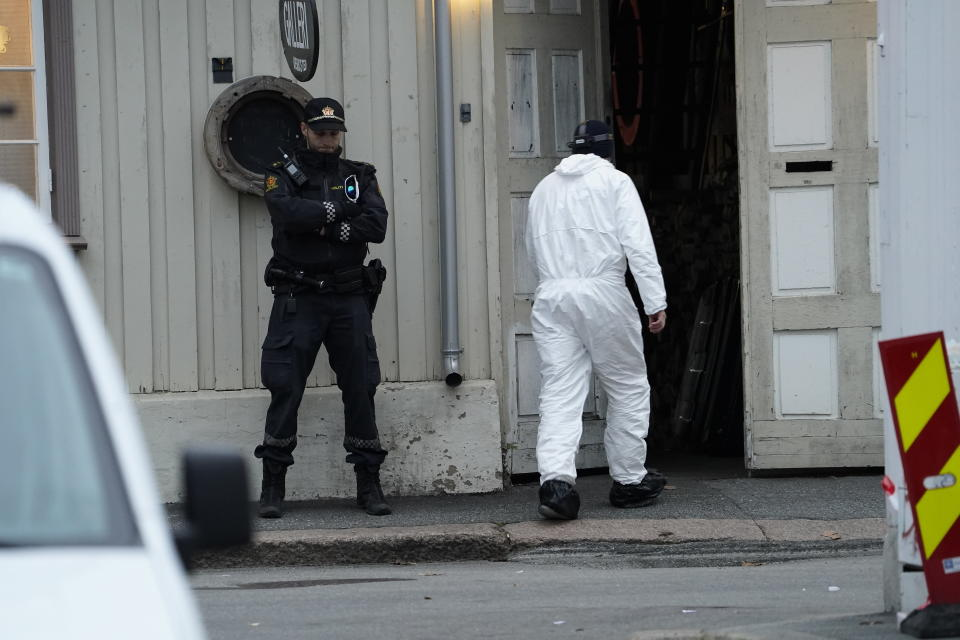 Police work near a site after a man killed several people, in Kongsberg, Norway, Thursday, Oct. 14, 2021. Police in Norway are holding a 37-year-old man from Denmark suspected in a bow-and-arrow attack in a small town that killed five people and wounded two others. (Terje Bendiksby/NTB via AP)