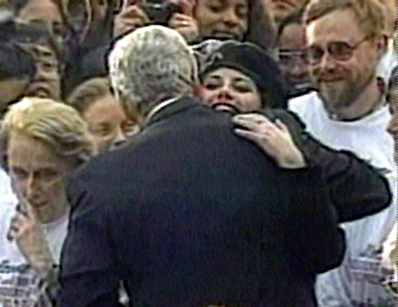 Monica Lewinsky embraces President Clinton as he greets well-wishers at a White House lawn party in Washington on Nov. 6, 1996.