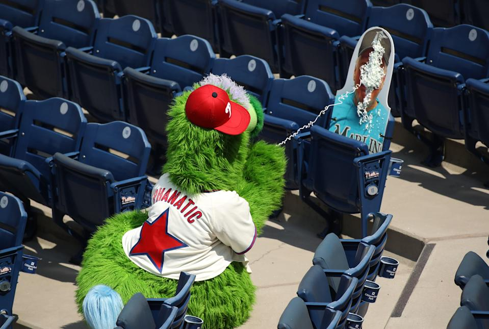 "<div class=""caption""> The Phanatic sprays a cardboard cutout of a Marlins' fan with Silly String during a July 26th game. </div> <cite class=""credit"">Icon Sportswire / Getty Images</cite>"