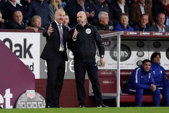 "Soccer Football - Premier League - Burnley vs Chelsea - Turf Moor, Burnley, Britain - April 19, 2018 Burnley manager Sean Dyche speaks with fourth official Anthony Taylor Action Images via Reuters/Andrew Boyers EDITORIAL USE ONLY. No use with unauthorized audio, video, data, fixture lists, club/league logos or ""live"" services. Online in-match use limited to 75 images, no video emulation. No use in betting, games or single club/league/player publications. Please contact your account representative for further details."