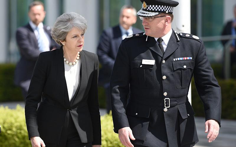 Theresa May with Chief Constable of Greater Manchester Police, Ian Hopkins, on Tuesday - Credit: OLI SCARFF/AFP