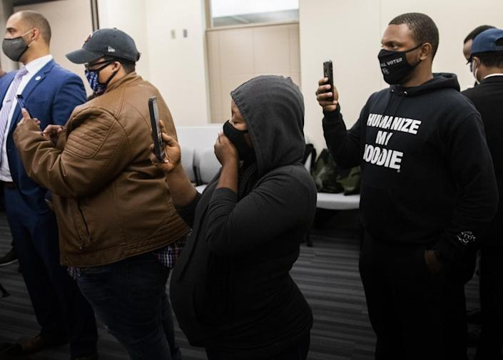 eople react after viewing the body camera footage of the killing of 20-year-old Daunte Wright