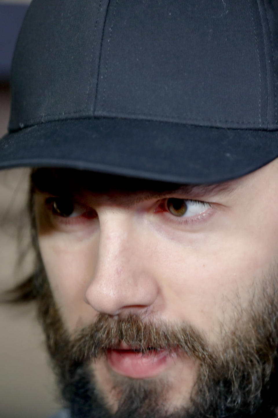Pittsburgh Penguins' Kris Letang talks with reporters in the practice facility locker room before leaving for the off season two days after being swept by the New York Islanders in the first round of the NHL hockey playoffs, Thursday, April 18, 2019, at their practice facility in Cranberry Township, Pa. (AP Photo/Keith Srakocic)