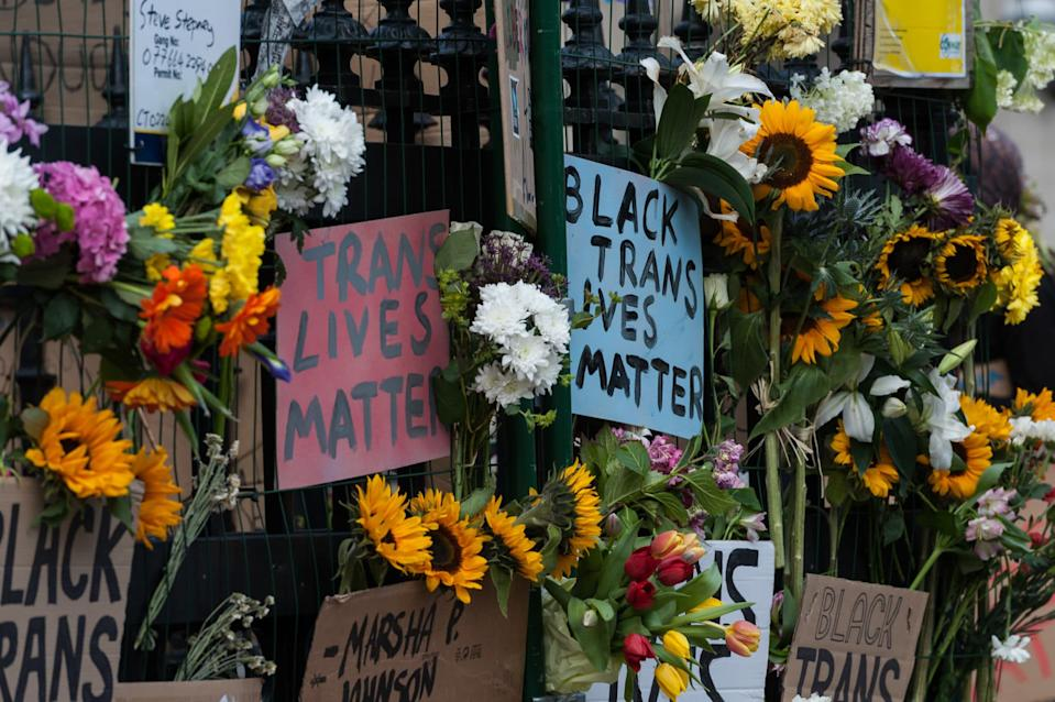 Flowers and placards after the Black Trans Lives Matter march in London, June 2020. (WIktor Szymanowicz/NurPhoto via Getty Images)
