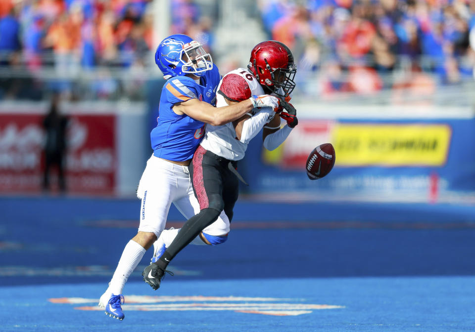 San Diego State cornerback Luq Barcoo, right, had the ball knocked out of his hands by Boise State wide receiver Sean Modster, left, to break up a possible interception in the second half of the NCAA college football game, Saturday, Oct. 6, 2018, in Boise, Idaho. San Diego State won 19-13.(AP Photo/Steve Conner)