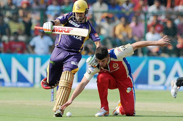 RCB player Henriques and Gambhir in action during the IPL match between RCB v/s KKR at Chinnaswamy Stadium,in Bangalore on Thursday 11th April 2013