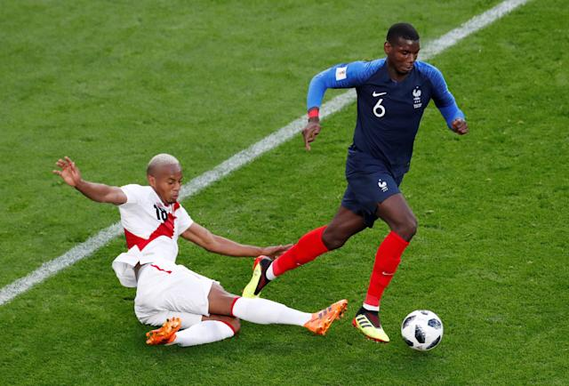 Soccer Football - World Cup - Group C - France vs Peru - Ekaterinburg Arena, Yekaterinburg, Russia - June 21, 2018 France's Paul Pogba in action with Peru's Andre Carrillo REUTERS/Andrew Couldridge