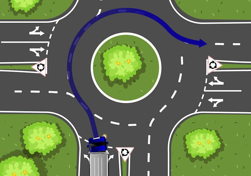 A truck is pictured at a two-lane roundabout.