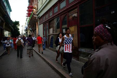 A man wearing the U.S. colours walks in downtown Havana, Cuba, January 12, 2017. REUTERS/Alexandre Meneghini