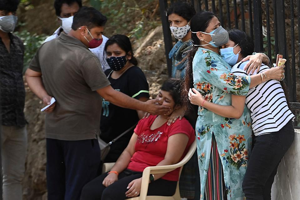 Relatives mourn their loved ones in Delhi