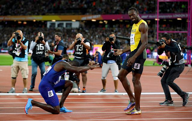 "Justin Gatlin of the U.S. kneels down in front of Usain Bolt of Jamaica after the final of the Men's 100 Metres final during the World Athletics Championships at London Stadium, London, Britain, August 5, 2017. REUTERS/Phil Noble/File Photo SEARCH ""POY SPORT"" FOR THIS STORY. SEARCH ""REUTERS POY"" FOR ALL BEST OF 2017 PACKAGES. TPX IMAGES OF THE DAY"
