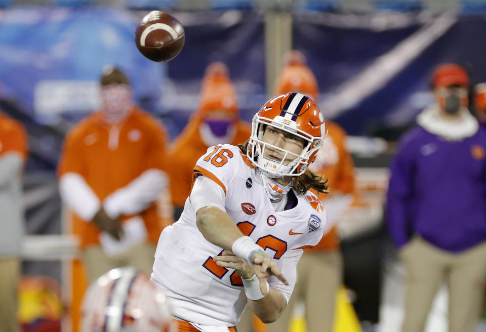 CHARLOTTE, NORTH CAROLINA - DECEMBER 19: Quarterback Trevor Lawrence #16 of the Clemson Tigers throws a pass in the fourth quarter against the Notre Dame Fighting Irish during the ACC Championship game at Bank of America Stadium on December 19, 2020 in Charlotte, North Carolina. (Photo by Jared C. Tilton/Getty Images)