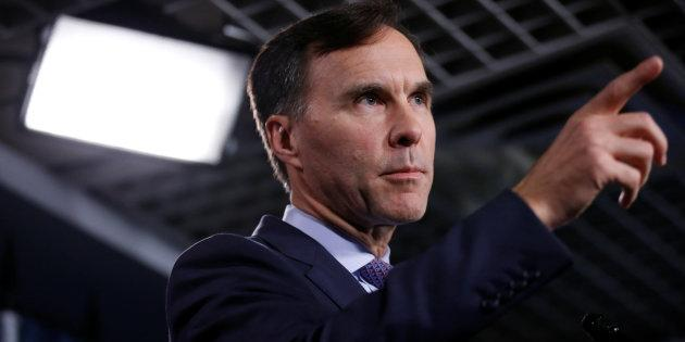 Finance Minister Bill Morneau gestures during a news conference on Parliament Hill on Oct. 19, 2017.