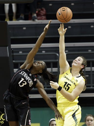 Stanford forward Chiney Ogwumike, left, battles for a rebound with Oregon forward Liz Brenner during the first half of an NCAA college basketball game in Eugene, Ore., Friday, Feb. 1, 2013. (AP Photo/Don Ryan)