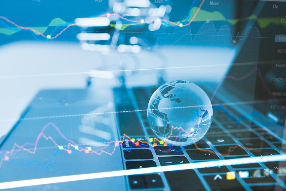 Business idea concept : World Wide currency trading trend concept, Clear crystal globe with world map with profit graph investor background. business ideas and competition and strategy plan.