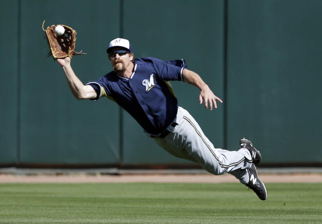 Milwaukee Brewers center fielder Kevin Mattison makes the catch for the out on a fly ball hit by Oakland Athletics' Daric Barton during the fourth inning of a spring training baseball game Thursday, Feb. 27, 2014, in Scottsdale, Ariz. (AP Photo/Gregory Bull)