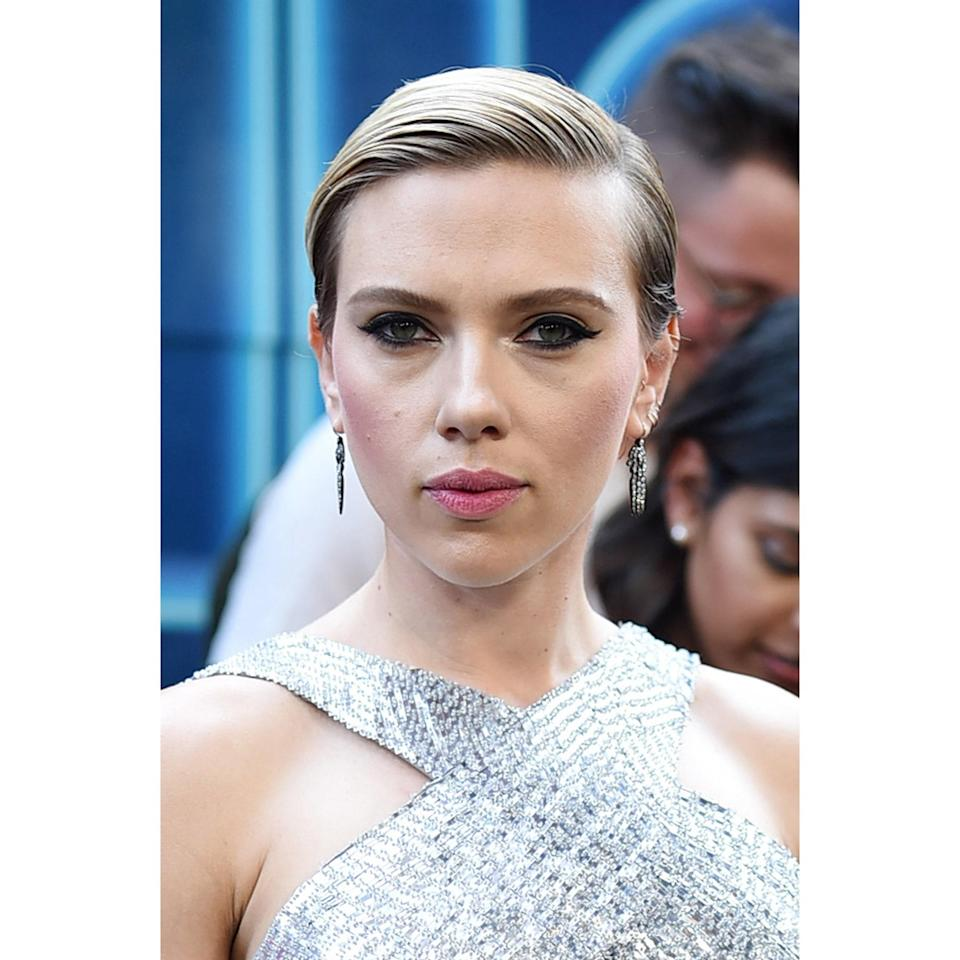 """<p>For the premiere of <em>Rough Night</em> in New York City, Scarlett Johansson parted her hair deep and on the side, then slicked it down for a glossy, shiny finish. """"This neat and clean hairstyle works well for short hair because it lures the focal point to the face, allowing your natural features to reign,"""" says hairstylist <a href=""""https://www.instagram.com/cataandaj/?hl=en"""" rel=""""nofollow noopener"""" target=""""_blank"""" data-ylk=""""slk:Cataanda James"""" class=""""link rapid-noclick-resp"""">Cataanda James</a>. """"The sleek structure requires little to no touch-ups and transitions well from day to night."""" </p> <p>Another benefit of this minimalistic look: """"It creates balance and doesn't compete with fashion elements,"""" says hairstylist <a href=""""https://www.instagram.com/pekelariley/?hl=en"""" rel=""""nofollow noopener"""" target=""""_blank"""" data-ylk=""""slk:Pekela Riley"""" class=""""link rapid-noclick-resp"""">Pekela Riley</a>. The simplicity of this hairstyle complements embellished garments with high necklines, like the actor's metallic gown here.</p>"""