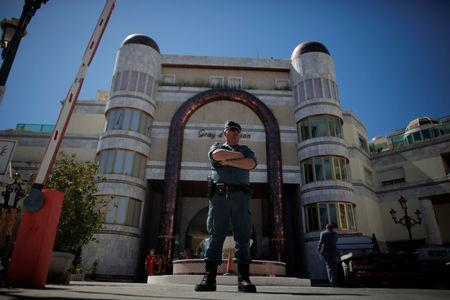 A Spanish Civil Guard officer stands guard outside the Gray D'Albion building at Puerto Banus in Marbella