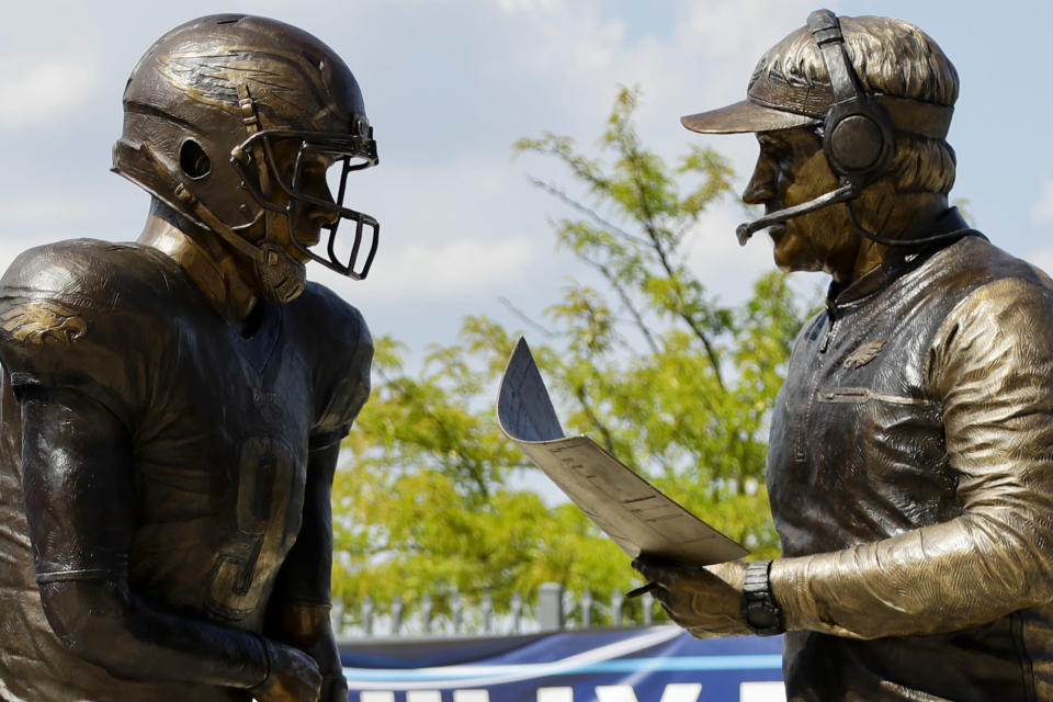 "FILE - In this Sept. 5, 2018, file photo, a bronze statue depicting Philadelphia Eagles quarterback Nick Foles, left, and head coach Doug Pederson discussing the ""Philly Special"" trick play is seen at Lincoln Financial Field, in Philadelphia. Facing the mighty New England Patriots on the NFL's biggest stage, Philadelphia Eagles coach Doug Pederson's decision to try a trick play _ the ""Philly Special"" _ on a fourth down late in the first half of Super Bowl 52 will be remembered as one of the gutsiest calls in sports history. (AP Photo/Matt Slocum, FIle)"