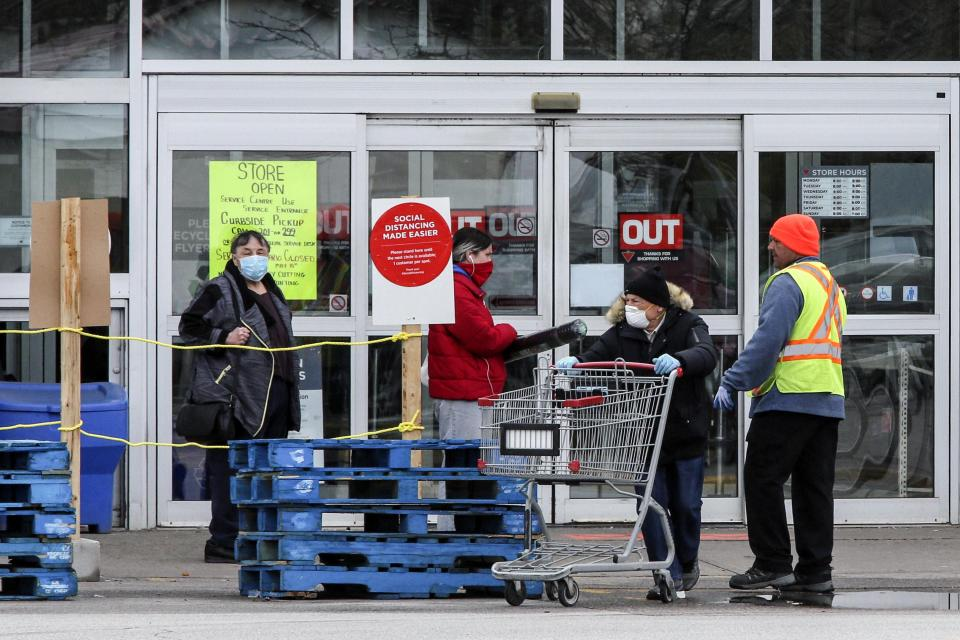 Customers wait to enter a Canadian Tire Store at 2129 St. Clair Ave. W. on May 11, 2020. Stores retail businesses are opening to the public after being closed to help stop the spread of COVID-19. (Andrew Francis Wallace/Toronto Star via Getty Images)