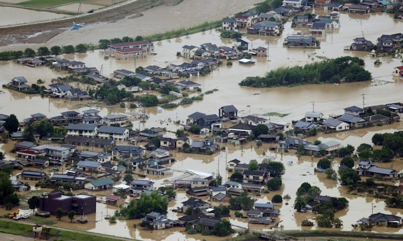 An aerial view of flooded homes in southwestern Japan, where more than 50 people have died as a result of the extreme weather.