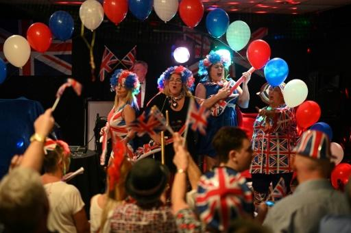 A band plays as Brexit supporters wave Union flags at a Brexit Celebration party at Woolston Social Club in Warrington, north west England