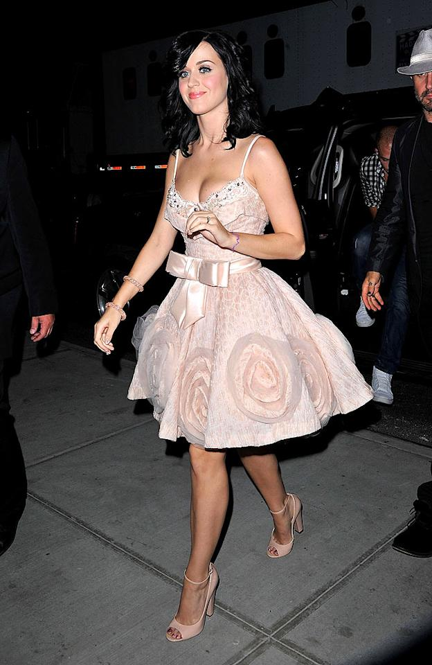 "Following her chat with Dave, Katy was shuttled to the Gansevoort Park Hotel, where she was spotted in a second stylish ensemble. Russell Brand's bride-to-be looked absolutely adorable in ankle strap peep-toes and a pink silk Zuhair Murad masterpiece, which featured a crystal-encrusted bustier, bow-adorned belt, and delicate rosette detailing. James Devaney/<a href=""http://www.wireimage.com"" target=""new"">WireImage.com</a> - August 24, 2010"