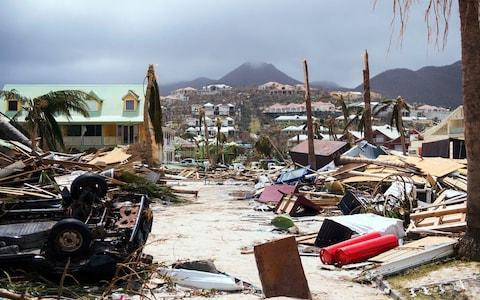 The fallout from Hurricane Irma is clear on Saint-Martin - Credit: LIONEL CHAMOISEAU/AFP
