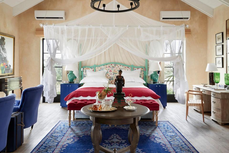 """<p><strong>Why did this hotel catch your attention? What's the vibe?</strong> Modern day Karen Blixen. You arrive down a driveway with a fountain and hanging lanterns and enter into a living room rather than a lobby with bold hued furnishings and modern African art. If you know Liz Biden's work you know you're in her home. It was so refreshingly different than any safari stay I've ever visited. The peacock blue bar pops and the two bartenders were at the ready to mix a fresh G&T with a side of olives and nuts.</p> <p><strong>What's the backstory?</strong> The Farmstead is the intimate sister property to <a href=""""https://www.cntraveler.com/hotels/south-africa/hoedspruit/royal-malewane?mbid=synd_yahoo_rss"""" rel=""""nofollow noopener"""" target=""""_blank"""" data-ylk=""""slk:Royal Malewane"""" class=""""link rapid-noclick-resp"""">Royal Malewane</a>, part of the Royal Portfolio owned by Liz and Phil Biden. In a pioneering partnership with the local community, the Royal Portfolio built the Farmstead at Royal Malewane and manages the lodge while paying lease fees to the community and employing their members. After 40 years, the community will own the lodge outright. Most hotels in the portfolio were former homes of the Bidens that Liz transformed. The Silo in <a href=""""https://www.cntraveler.com/destinations/cape-town-south-africa?mbid=synd_yahoo_rss"""" rel=""""nofollow noopener"""" target=""""_blank"""" data-ylk=""""slk:Cape Town"""" class=""""link rapid-noclick-resp"""">Cape Town</a> and the Farmstead are new builds.</p> <p><strong>Tell us all about the accommodations. Any tips on what to book?</strong> I stayed in a Farm Suite. I loved the paintings of neon caricatures from artist Ralph Krall's series Karoo Ladies that are in the rooms and the canopied beds with floral patterned headboards. The bathrooms are palatial and have clawfoot bathtubs as well as outdoor showers on the decks. The design would have easily fit in in <a href=""""https://www.cntraveler.com/destinations/cape-town-south-africa?mbid=synd_yahoo_rss"""" rel="""