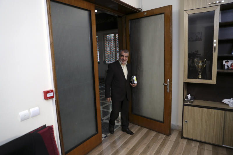 In this Nov. 9, 2019, photo, Abbas Ali Kadkhodaei, a prominent member of Iran's powerful Guardian Council, arrives for an interview with The Associated Press in, Tehran, Iran. A prominent member of Iran's powerful Guardian Council has told The Associated Press that the Islamic Republic should stop honoring the terms of its collapsing 2015 nuclear deal with world powers amid tensions with the U.S. (AP Photo/Vahid Salemi)