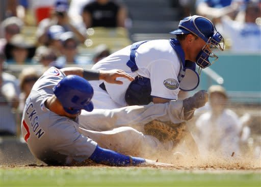 Chicago Cubs' Brett Jackson scores past Los Angeles Dodgers catcher A.J. Ellis on a double by Alfonso Soriano during the seventh inning of a baseball game on Sunday, Aug. 5, 2012, in Los Angeles. It was Jackson's first career run in his big league debut. (AP Photo/Danny Moloshok)