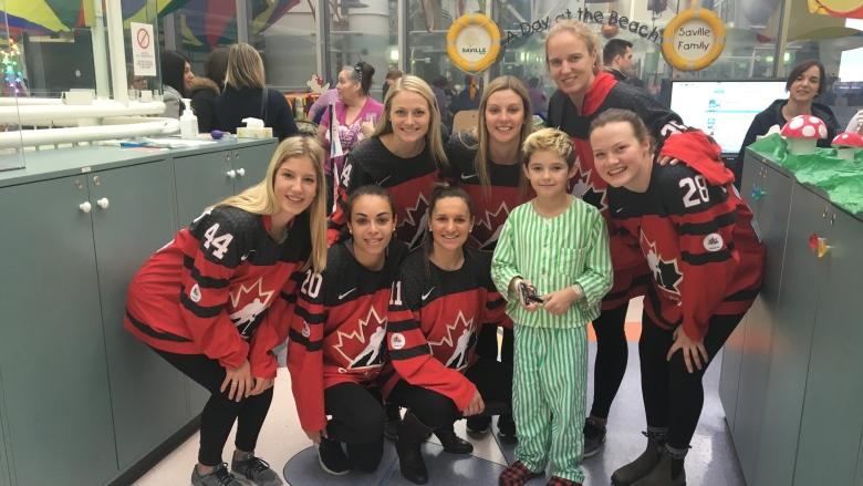Team Canada scores points with visit to children at Stollery Hospital