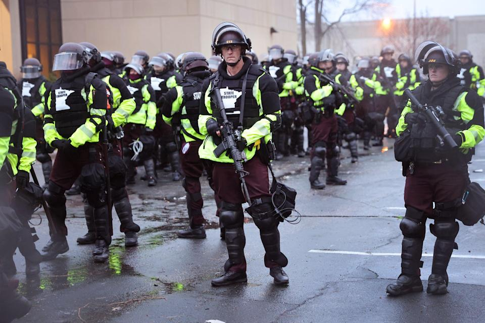 Police officers stand guard outside of the Brooklyn Center police station on April 12, 2021 in Brooklyn Center, Minnesota (Getty Images)