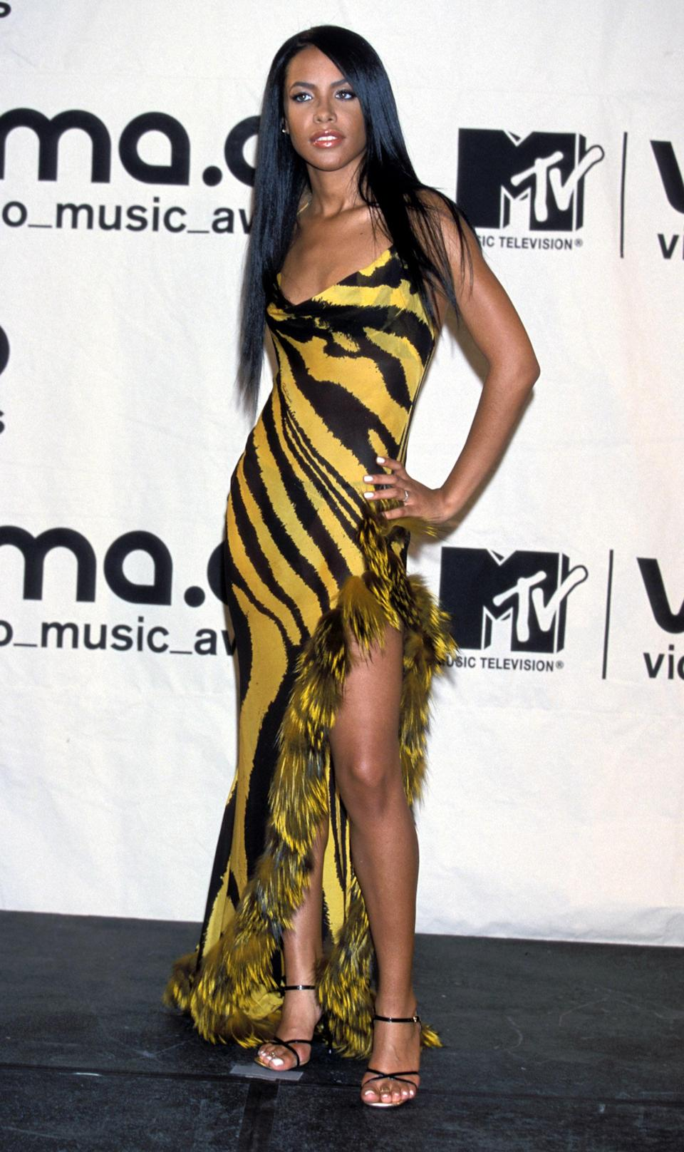Aaliyah had the kind of effortless swag and beauty that artists are still trying to capture today. Her black and yellow Roberto Cavalli gown was so fashion-forward, that it literally looks like a design we'd see on the red carpet this season.